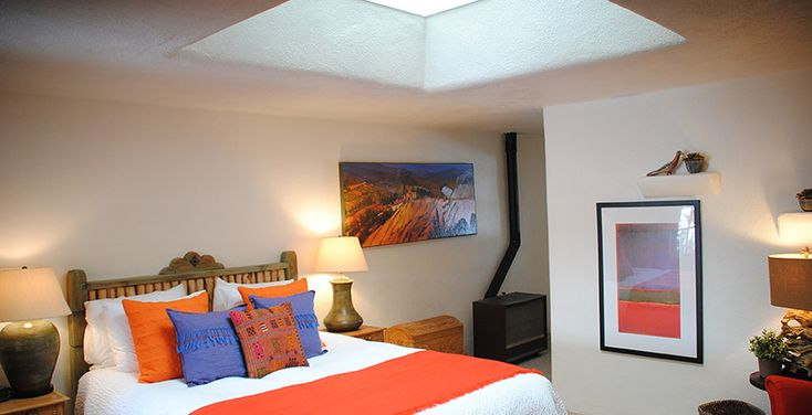 You can watch the clouds and stars under a large skylight from the well-appointed queen bed. Free Wi-Fi, hand made southwestern furniture, Mexican tiled bathroom and private patio under the trees.