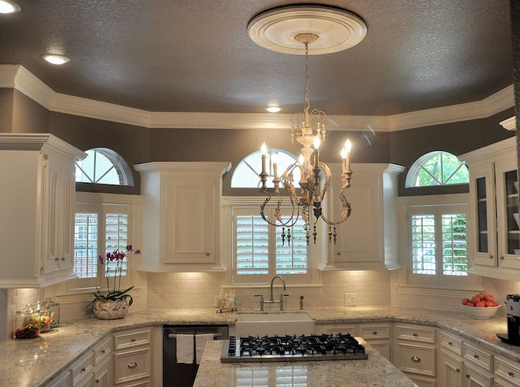 Beautiful kitchen.  Love the wall color!  Plantation shutters on the windows.