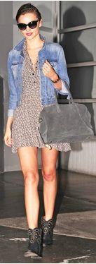 Miranda Kerr wearing floral print dress, denim jacket, and western style boots
