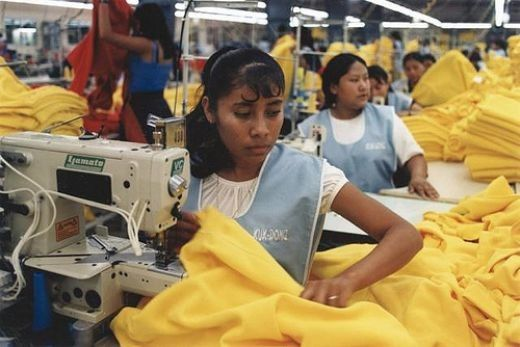 This is another sweatshop showing young ladies sewing for a company