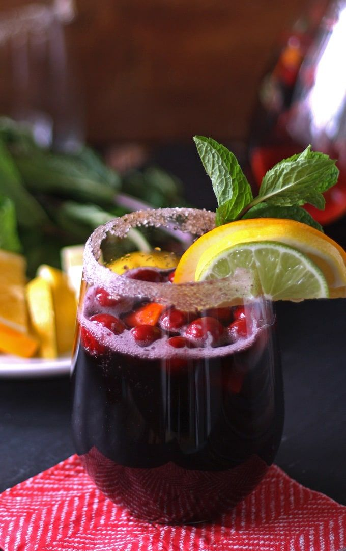 Winter Sangria Recipe - the perfect drink for all of your holiday parties. | www.honeyandbirch.com | #cocktail #drink