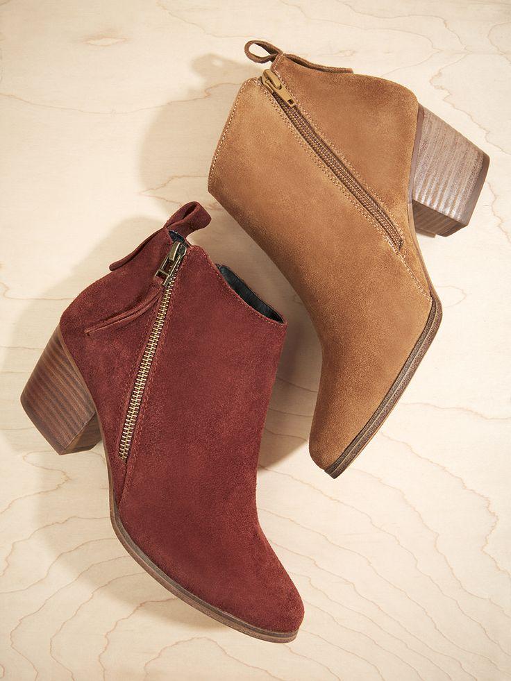 Asymmetrical zip booties in cognac and bordeaux suede