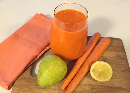 """A New Orange Juice: 8 medium carrots, 1 pear, 1 lemon 1"""" piece of ginger, 3 – 4 kale leaves (optional — I left them out because I wanted the pretty orange color!)"""