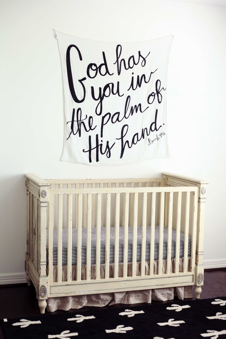 God has you in the palm of his hand tapestry blanket above the crib. #nursery #newborn #homedecor