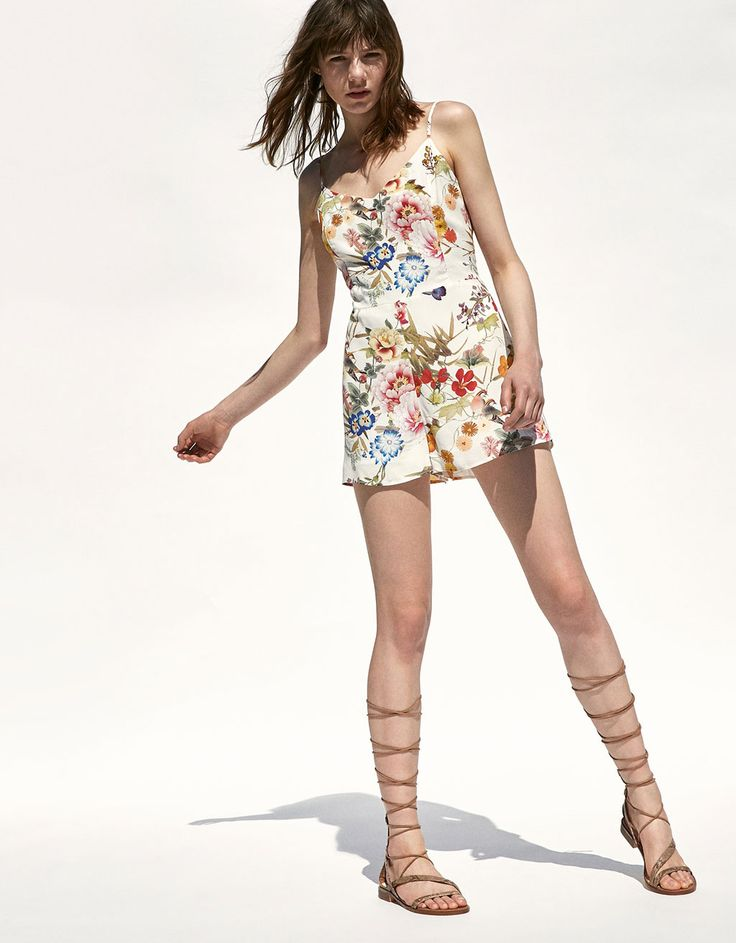 Floral print short romper. Discover this and many more items in Bershka with new products every week