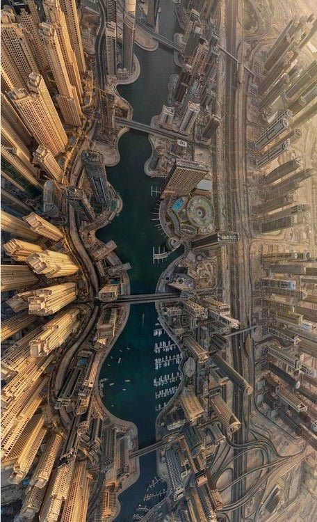 """INTRIGUING ARCHITECTURE. When we look UP at the Tallest Buildings of the world, we sometimes forget to wonder what it's like looking DOWN. #DdO:) MOST POPULAR RE-PINS - http://www.pinterest.com/DianaDeeOsborne/intriguing-architecture/ - Shown: Aerial view of Dubai City. Research: The world's tallest man-made structure is the 829.8 m (2,722 ft) tall Burj Khalifa in Dubai, United Arab Emirates. It gained official title of Tallest Building in the World"""" at its opening on January 4, 2010…"""