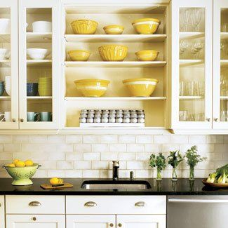 Love the Subway Tile with the open cabinets and black counters.