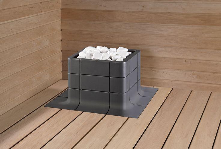 Nuoska integrated sauna heater in dark grey was introduced at Habitare. Google Image Result for http://www.tulikivi.fi/kuvat/kuvap/sauna/DECO_NUOSKA_GRAFIITTI_INTEGROITU_VALKOISET_KIVET_rgb.jpg