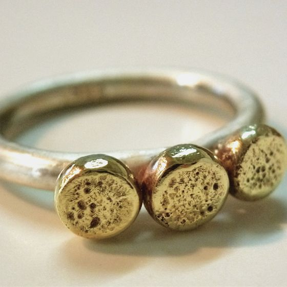 Sterling silver and brass ring inspired by a traditional engagement ring. Created by ntm. jewellery