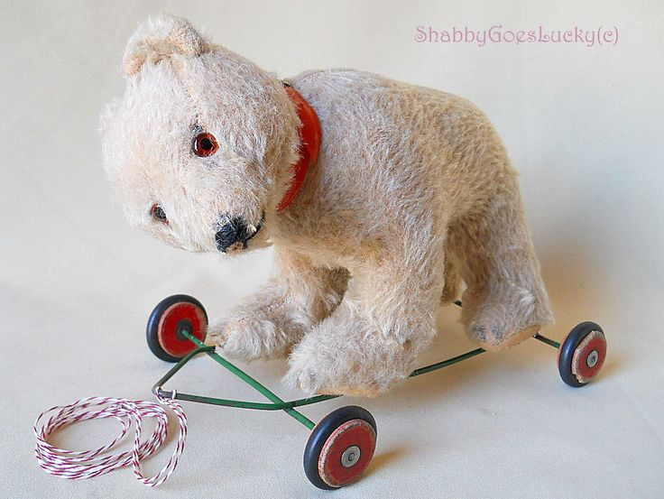 Vintage polar bear on wheels, 1950s white mohair bear with swivel head on metal frame with wood & rubber wheels, old pull along toy by ShabbyGoesLucky on Etsy https://www.etsy.com/listing/224421220/vintage-polar-bear-on-wheels-1950s-white