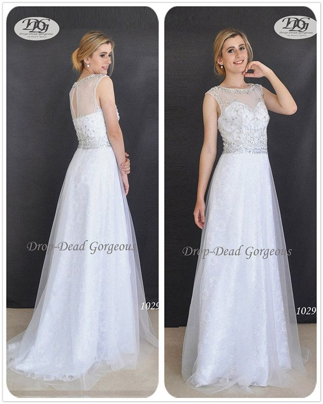 Tulle Wedding Dress:  Tulle with metallic lace underlay wedding gown, featuring an intricate beaded bodice.  #DDGMA #DropDeadGorgeous #MiracleAgency #Weddingdress #weddings www.miracleagency.net