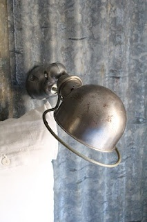 Industrial light in metal colour. Can turn to all sides (comes in handy for reading at night!). Such a lovely lamp... <3 Bedroom