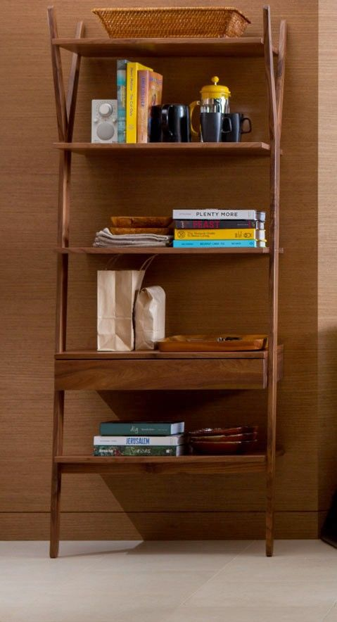 Combining function with details taken from tree branches, this leaning shelving unit is an easy way to display your collectibles while adding interest and shape to a room.