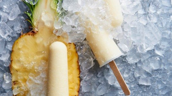These adult rum, pineapple, and coconut milk frozen pops are a great way to beat the heat in the summertime or, really, anytime!