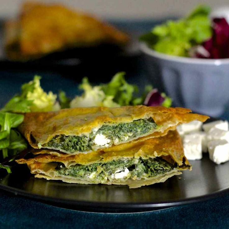 Spanakopita is a famous traditional Greek recipe which consists of a phyllo dough based pie stuffed with spinach and herbs.