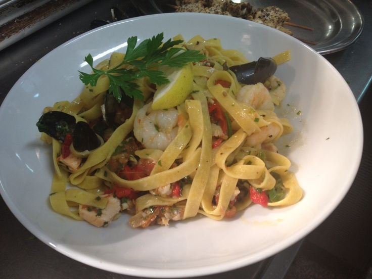 Seafood tagliatelle with fresh clams and mussels with a hint of chilli, white wine, tomato and parsley