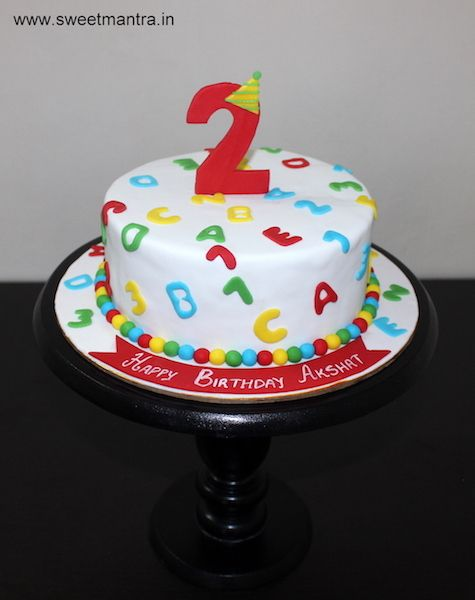Alphabets and Numbers theme small customized designer fondant cake for boy's 2nd birthday at Wakad, Pune