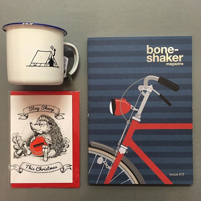 The long awaited issue 17 of the awesome  @boneshakermag has just arrived & is now available in store, along with a huge selection of cards & gifts   @robmason_art #ngngsesign #robmasonart #boneshakermag #magazine #illustration #christmas #gifts #greetingscards #bicycle #bikelovers #exeter