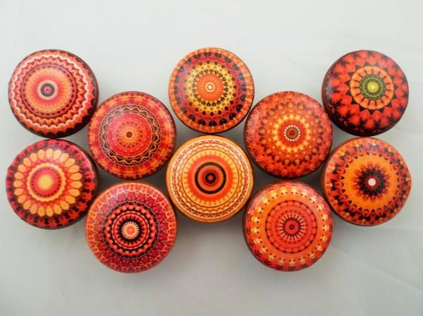 "Set of 10 orange mandala print wood knobs are 1.5"" wide and have been stained English chestnut with a decoupage mandala pattern. Sealed with a triple coat gloss"