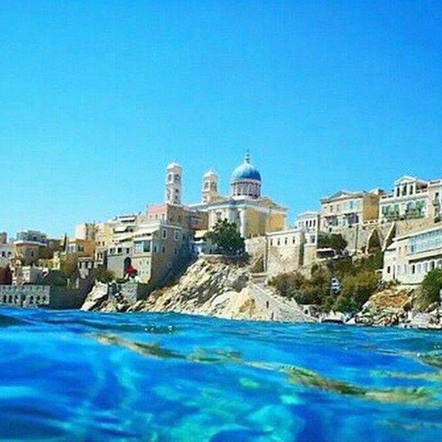 Amazing kind of view , into the clear blue sea at Syros island (Σύρος) .