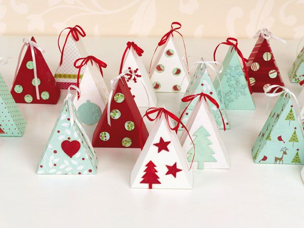 Des petites boites en forme de sapin, idéal pour contenir bonbons, chocolats et autres friandises en attendant le Père Noël !