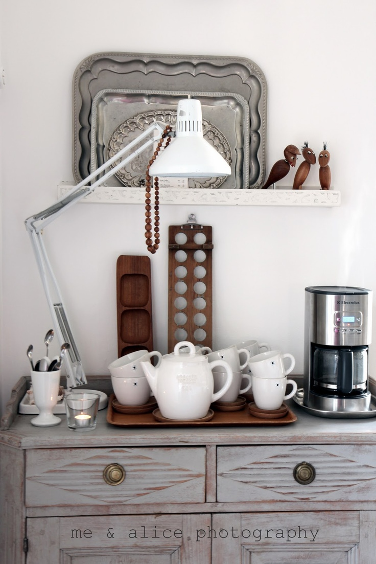 coffee corner. love the inclusion of a lamp (great for early mornings), and serving trays on the shelf are neat (for treating guests)