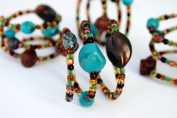 These beaded napkin rings were inspired by my hometown of Santa Fe, NM with their shades of turquoise, teal, amber, bronze and ochre. Set of 4.