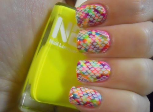 """""""All I did was make dots with my different neon polishes and then stamped overtop. I recommend putting a coat or two of a white polish down on your nails first before starting with the neons, it will make them more opaque.""""    (via Holy Manicures: Neon Snakeskin Nails.)"""