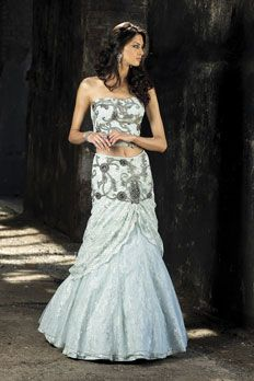 Net and Chantilly lace ghagra with corset blouse, embellished with stone and sequins work.