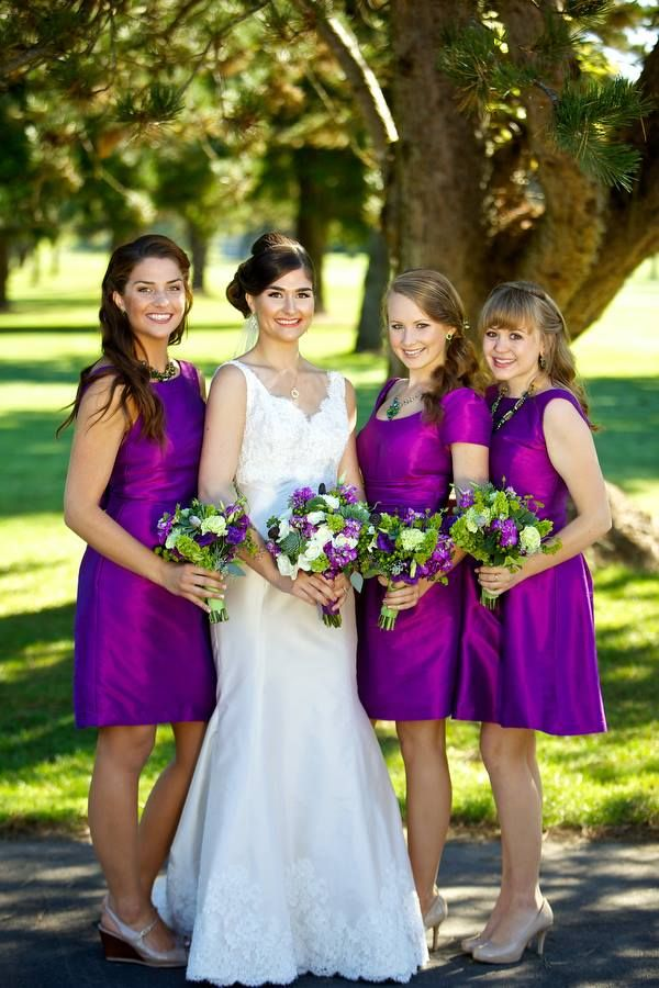 Such a gorgeous color for your bridesmaid dress. Especially with those green and purple bouquets! Also, love that the bridesmaids are all in mix and match dresses by Alfred Sung. Gorgeous photo all around