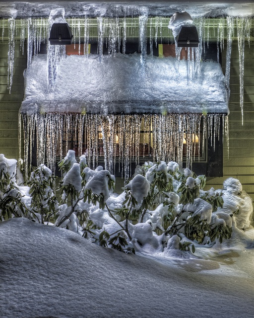 Ice hung from windows on a snowy Christmas eve.....