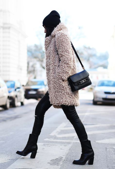 Put together your best all-black outfit and throw on an oversized fuzzy coat in a different color for contrast. You'll stay warm this winter AND make a statement. Let DailyDressMe help you find the perfect outfit for whatever the weather!