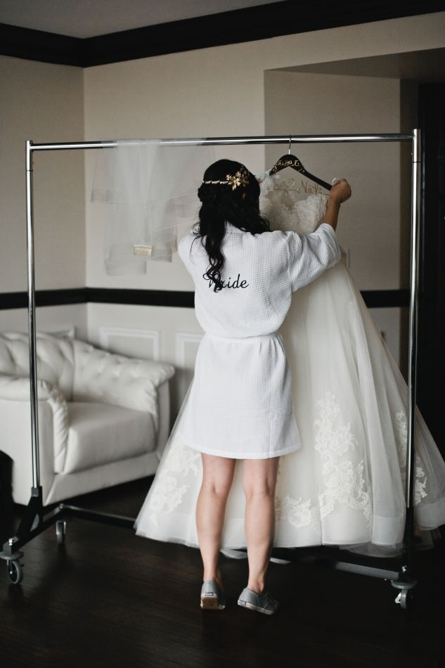 One Fine Day bride, Tu, getting ready for her big day! She looked stunning in her custom Lazaro ballgown! Photographed by Della Terra Photo.