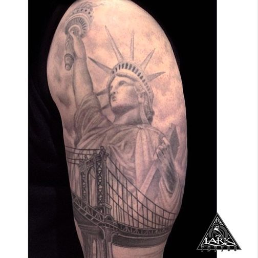 Tattoo by our artist Jason Gorman. See more of Jason's work at: http://www.larktattoo.com/long-island-team-homepage/jay/  statue of liberty, Brooklyn bridge, black and gray, usa