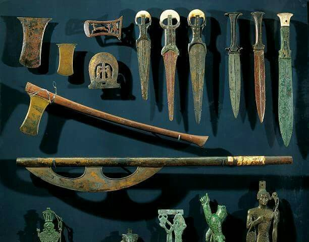 Ancient Egyptian bronze axes and daggers with electrum blades and ivory handles.