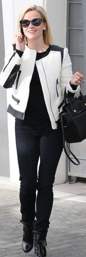 Who made  Reese Witherspoon's black tote handbag and white zipper jacket?