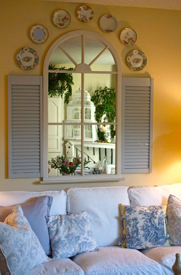 just did this over the mantle with shutters and 6 pane window I bought years ago with mirrors inside panes...no plates just a wooden scroll plaque over window....looks nice!!! DL