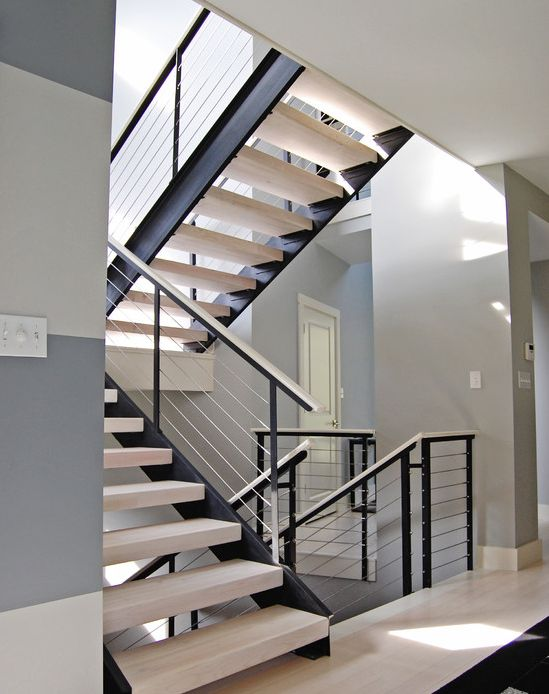 Extensive modern staircase with cable railing by Stainless Cable & railing. | Modern Home Interior Design