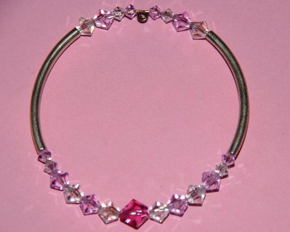 A piece of elegance.  Adults Swarovski Crystal bracelet  pink by Tazzmck on Etsy