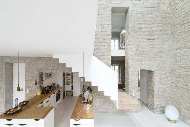 Conversion of an ancient miller's house into a home for a family with tree kids by asdfg Architekten. The project is situated in Berlin, Germany.