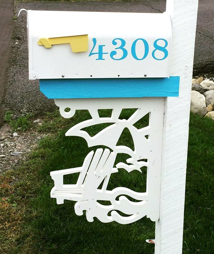 A perfect mailbox design for a beach cottage! Blue and white with a touch of sunny yellow and a great beachy corner bracket from Island Creek Designs: http://www.islandcreekdesigns.com/corner-brackets