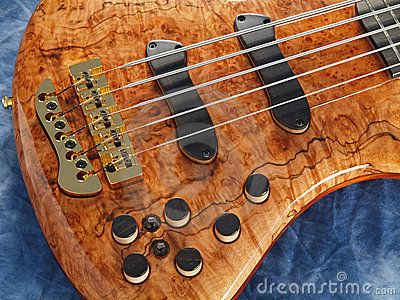 close ups of squier stratocaster | Royalty Free Stock Photography: Curved patterned wood bass guitar ...