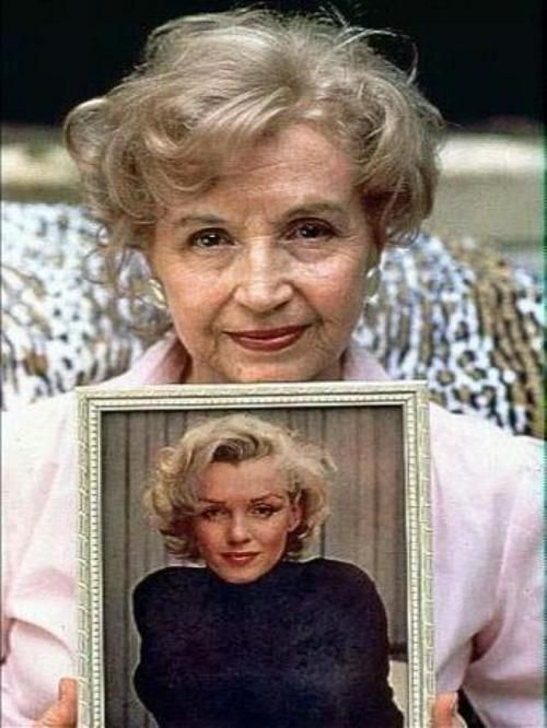 Marilyn's half sister Berniece Miracle holding a photograph of Marilyn. Berniece is the closest relative to Marilyn that is still alive today. Many fans find her fascinating, given the fact that she gives us an insight into what Marilyn may have looked like had she lived into old age.