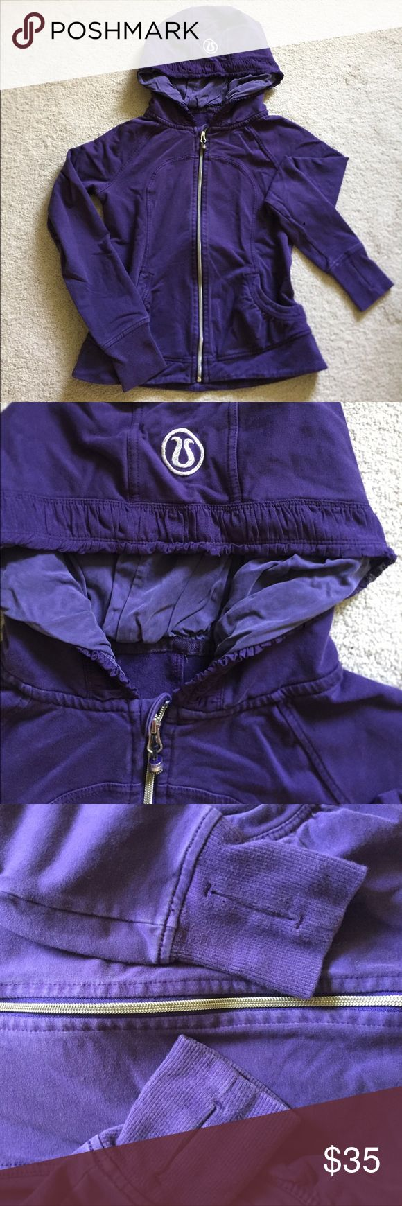 Purple Lululemon Hoodie Adorable purple lululemon hoodie.  Has ribbon edging around the hood and beaded logo at end of zipper still attached.  Definite fading on this, but material is still in good condition. lululemon athletica Tops Sweatshirts & Hoodies