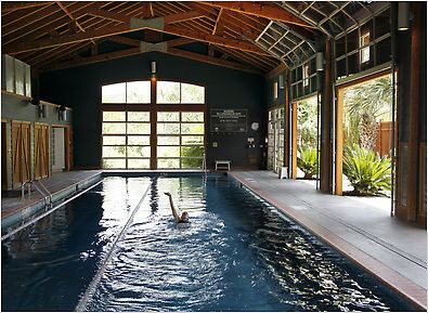 Indoor barn pool lake austin spa mood enhancers for Cost to build a pool house with bathroom