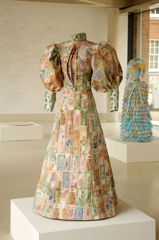 """Susan Stockwell is an amazing British artist that uses technology, ecology and politics in her works while also incorporating recycled computer parts and other everyday materials. Here we have """"The Money Dress"""" which she designed and was made with paper money from all over the world."""