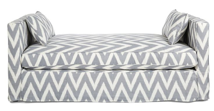 Elegantly slipcovered in chevron linen with a wraparound skirt that reaches the floor, this daybed has a frame made of alder, a hardwood prized for its stability. The cushion fill--lofty feathers...