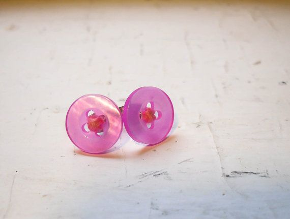 These pretty in pink colored plastic button earrings are detailed with pink cotton thread to fill them up with even more love. Tried and true, these studs are secured with jewelry cement, and snuggle up to your ear with the help of tarnish-resistant earring backs.  $10.50