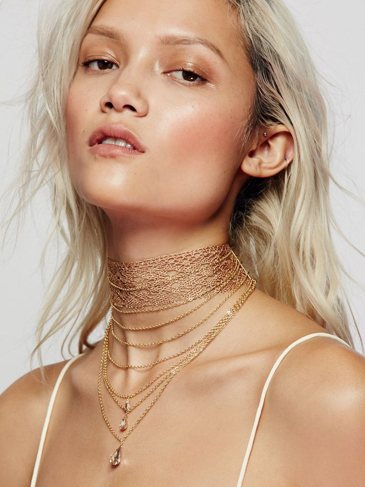 Alexandria Draped Lace Choker   Shimmering wide lace choker featuring delicate chains dangling below with pretty teardrop accents. Adjustable lobster clasp closure.