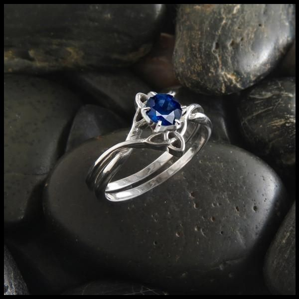 Interlocking engagement ring two piece set with Sapphire.